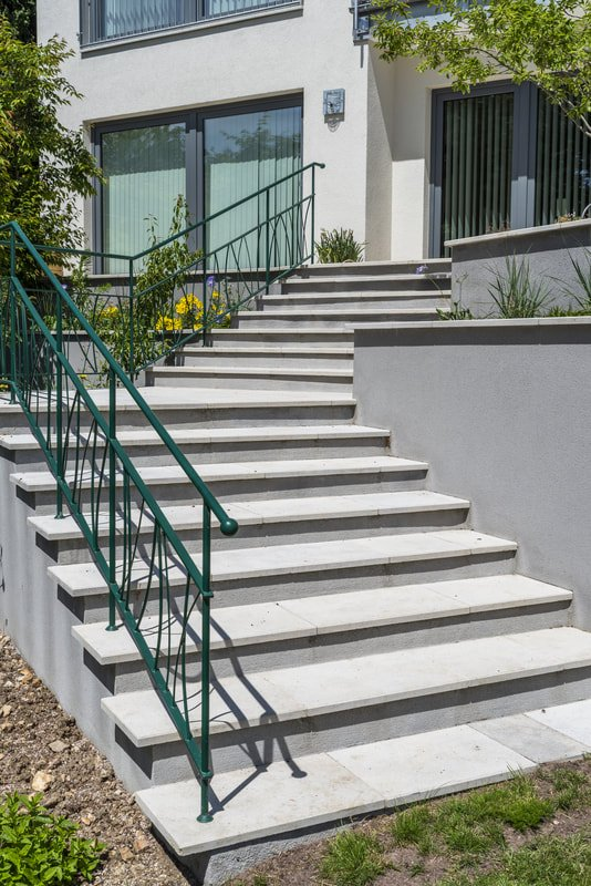 Bespoke Garden Concrete Staircase with Green Handrail